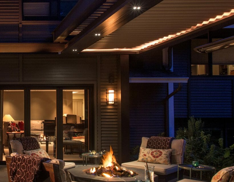 dusk patio view with cushy outdoor furniture around fire in fire pit