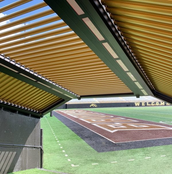 Standing under Western Michigan University football stadium chute black frame gold adjustable louvers