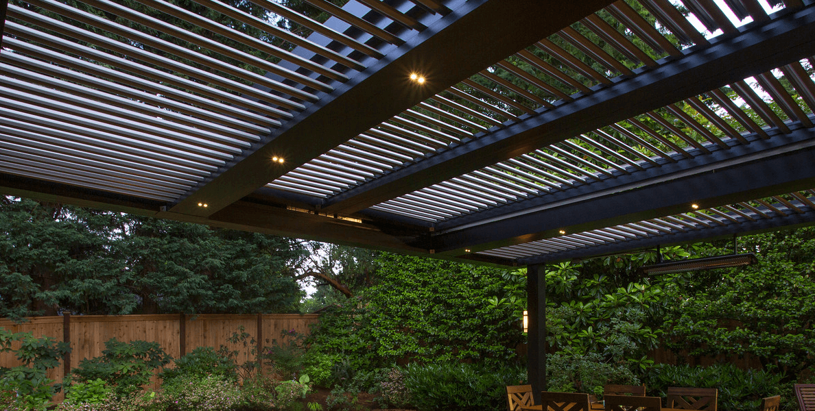Bronze pergola slid closed with views of trees and sky beyond and u