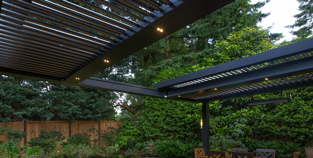 Bronze pergola slid open with views of trees and sky beyond and underneath
