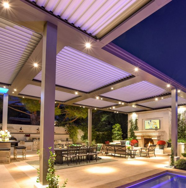 Spot lights shine like stars on underside of bronze pergola at night
