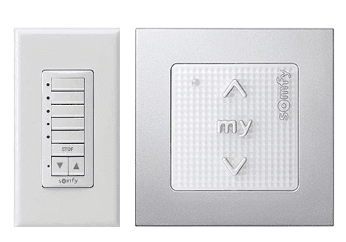 Close-up of two Somfy switch plates one with 8 buttons and the other with one